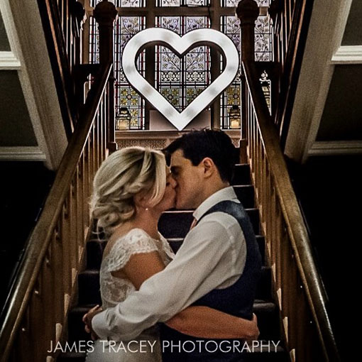 Couple kissing with Light up Kissing Heart at Didsbury House Hotel