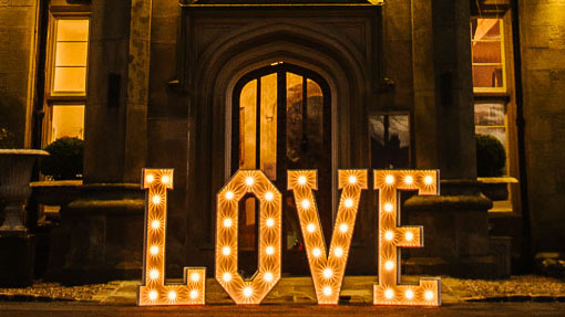 light up sparkle love letters outside wedding venue