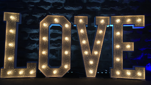 Silver Glitter Light up Love letters with our Bar uplighters set to blue