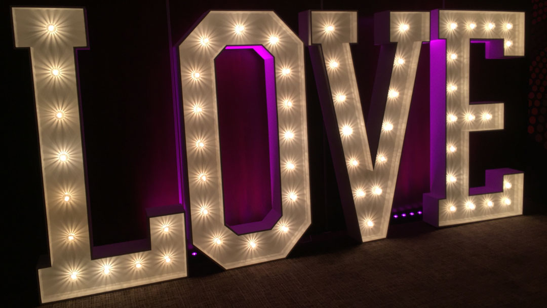 back lit love venue lighting by the word is love