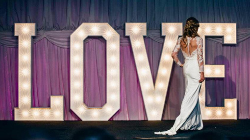 bride in front of supersize giant light up love letters full