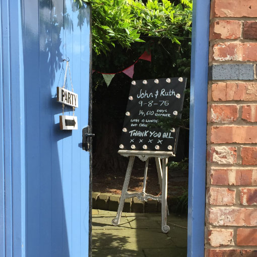 light up chalkboard message board through a blue door