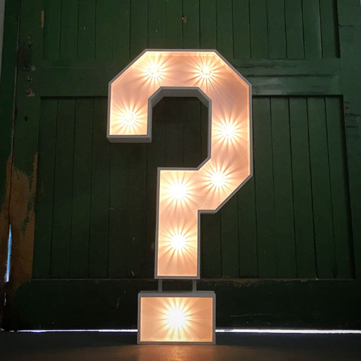 light up letter question mark in front of rustic green door