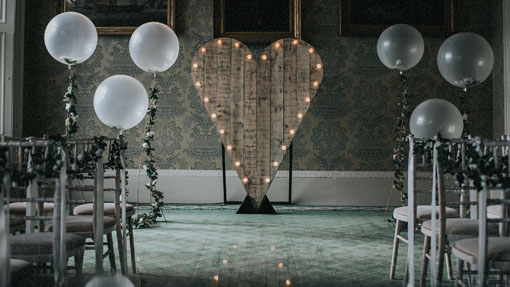 rustic heart backdrop ceremony setting