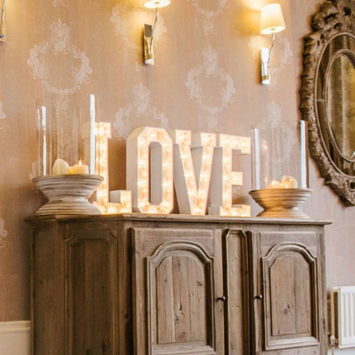 table top light up love letters by the word is love