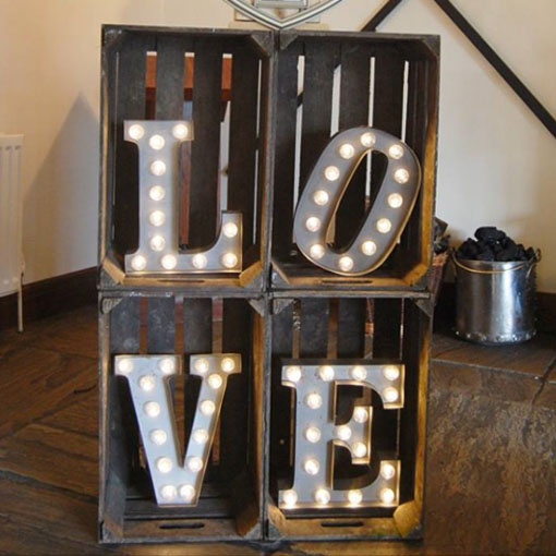 vintage apple crates with light up letters spelling love
