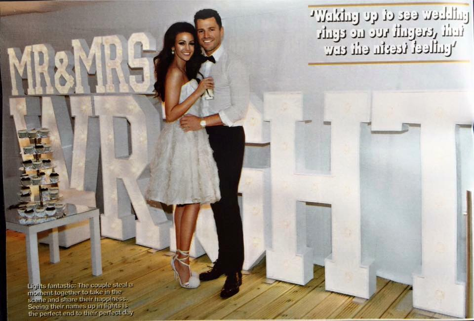 michelle keegan and mark wright celebrities pose in front of the word is love letters